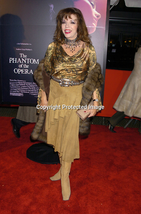 "Joan Collins..at The New York Premiere of ""Phantom of the Opera"" on ..December 12, 2004 at the Ziegfeld Theatre. ..Photo by Robin Platzer, Twin Images"
