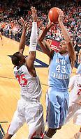 North Carolina forward James Michael McAdoo (43) shoots over Virginia forward Akil Mitchell (25) during an NCAA basketball game against Virginia Monday Jan. 20, 2014 in Charlottesville, VA. Virginia defeated North Carolina 76-61.
