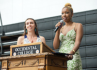 From left, Cordelia Kenney '14 and Jazmine Brand '14, Class Day coordinator talk during Senior Brunch and Class Day, May 16, 2014 in Rush Gym. (Photo by Marc Campos, Occidental College Photographer)