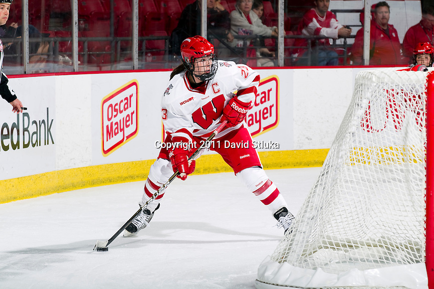 Wisconsin Badgers Hilary Knight (23) handles the puck during an NCAA women's hockey game against the Minnesota Golden Gophers on October 14, 2011 in Madison, Wisconsin. The Badgers won 3-2. (Photo by David Stluka)