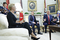 Polish First Lady Agata Kornhauser-Duda (L) with US President Donald J. Trump (R) and Polish President Andrzej Duda (C) during a meeting in the Oval Office of the White House in Washington, DC, USA, 12 June 2019. Later in the day President Trump and President Duda will participate in a signing ceremony to increase military to military cooperation including the purchase of F-35 fighter jets and an increased US troop presence in Poland. <br /> Credit: Shawn Thew/CNP/AdMedia