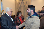 Palestinian President Mahmoud Abbas meets with journalist Moaz Amarna in the West Bank city of Bethlehem, on December 24, 2019. Photo by Thaer Ganaim