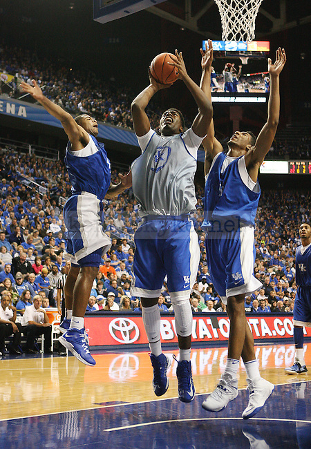 Kentucky Wildcats center Dakari Johnson (44) jumps to shoot the ball during the second half of the Blue-White scrimmage at Rupp Arena in Lexington, Ky., on Tuesday, October 29, 2013. Photo by Tessa Lighty | Staff