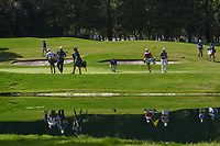 Jon Rahm (ESP), Rickie Fowler (USA), and Patrick Reed (USA)look over their putts on 6 as they reflect off the pond during round 1 of the World Golf Championships, Mexico, Club De Golf Chapultepec, Mexico City, Mexico. 2/21/2019.<br /> Picture: Golffile | Ken Murray<br /> <br /> <br /> All photo usage must carry mandatory copyright credit (© Golffile | Ken Murray)