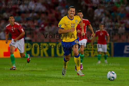 Sweden's Zlatan (front) Ibrahimovic leads the ball during the UEFA EURO 2012 Group E qualifier Hungary playing against Sweden in Budapest, Hungary on September 02, 2011. ATTILA VOLGYI