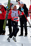 HOLMENKOLLEN, OSLO, NORWAY - March 17: Therese Johaug of Norway (NOR) celebrates her win during the prize giving ceremony of the Ladies 30 km mass start race, free technique, at the FIS Cross Country World Cup on March 17, 2013 in Oslo, Norway. 2nd place Justyna Kowalczyk of Poland (POL) and 3rd place Yulia Tchekaleva of Russia (RUS). (Photo by Dirk Markgraf).