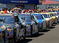 Apr 25, 2009; Talladega, AL, USA; NASCAR Sprint Cup Series cars are lined up after being impounded following qualifying for the Aarons 499 at Talladega Superspeedway. Mandatory Credit: Mark J. Rebilas-