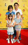 "SANTA MONICA, CA. - November 16: Actress Lisa Rinna, Actor Harry Hamlin and children arrive at the 11th Anniversary Of P.S. Arts ""Express Yourself 2008"" at the Barker Hanger at the Santa Monica Airport on November 16, 2008 in Santa Monica, California."