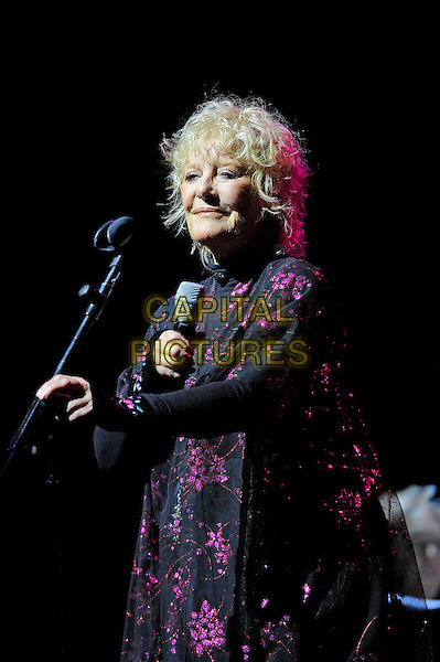 Petula Clark <br /> performing in concert, Theatre Royal, Drury Lane, London, England. <br /> 13th October 2013<br /> on stage live gig performance music black purple floral print jacket <br /> CAP/MAR<br /> &copy; Martin Harris/Capital Pictures
