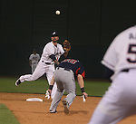 Aces second basemen Ryan Roberts throws over the head of Rainiers runner Adam Moore in a double play attempt. Photo by Tom Smedes.