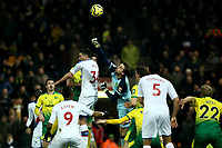 1st January 2020; Carrow Road, Norwich, Norfolk, England, English Premier League Football, Norwich versus Crystal Palace; Tim Krul of Norwich City punches the ball clear as Kelly of West Ham challenges - Strictly Editorial Use Only. No use with unauthorized audio, video, data, fixture lists, club/league logos or 'live' services. Online in-match use limited to 120 images, no video emulation. No use in betting, games or single club/league/player publications