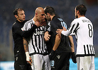 Calcio, quarti di finale di Coppa Italia: Lazio vs Juventus. Roma, stadio Olimpico, 20 gennaio 2016.<br /> Juventus's Simone Zaza, second from left, faces Lazio's Senad Lulic, second from right, at the end of the Italian Cup quarter final football match between Lazio and Juventus at Rome's Olympic stadium, 20 January 2016. Juventus won 1-0.<br /> UPDATE IMAGES PRESS/Isabella Bonotto