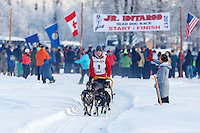 Rebeckah Stephan on the trail after leaving the start at Knik during the start of the Junior Iditarod on Saturday February 25, 2017. <br /> <br /> <br /> Photo by Jeff Schultz/SchultzPhoto.com  (C) 2017  ALL RIGHTS RESVERVED