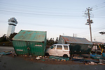Mar. 13, 2011 - Ibaraki, Japan - A vehicle is seen smashed between freight contrainers in Oarai two days after the 8.9 magnitude earthquake followed by a tsunami that hit the north-eastern region of Japan. The current number of deaths in this disaster are reported to be well into the thousands according to media reports.