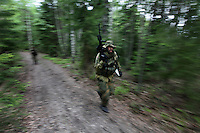 Lieutenant Ole runs through a forest during a reconnaissance mission. Norwegian Home Guard soldiers during exercise Djerv..The Home Guard has traditionally been designated to secure important  domestic installations in case of war or crisis. With the cold war long gone, a war in Afghanistan and budget cuts, there is a debate over the Home Guard's role in the future.