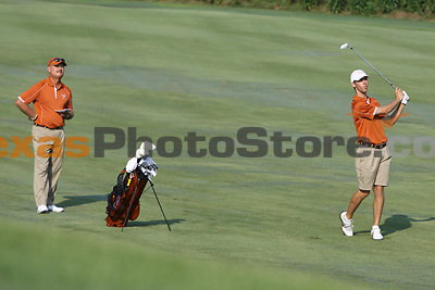 University of Texas senior Brax McCarthy hits from the fairway as coach John Fields watches during the Carpet Capital Collegiate at The Farm Golf Club in Rocky Face, Ga., on Sunday, Sept. 8. The Longhorns return to The Farm as defending champions after shooting a 13-under 851 in 2012.<br /> <br /> Photo by Patrick Smith