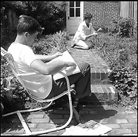 BNPS.co.uk (01202 558833)<br /> Pic: Bonhams/BNPS<br /> <br /> Jackie does some gardening while Jack relaxes.<br /> <br /> Fascinating photographs of the Kennedys during their first year of marriage have emerged for auction.<br /> <br /> The intimate snaps of the future US president and his wife Jackie were taken by renowned photographer Orlando Suero who spent five days with the couple at their Georgetown home in May 1954.<br /> <br /> At the time, Kennedy was a young senator from Massachusetts establishing himself as one to watch on the US political scene.<br /> <br /> The collection's owner, Max Lowenherz, donated the bulk of the photographs and negatives to the Peabody Institute of Johns Hopkins University in Maryland, USA.<br /> <br /> He has now decided to put 31 of them up for auction and they are tipped to sell for &pound;4,900 ($6,000).