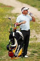 Paul Mcginley takes some water while he lines up his 2nd shot from the rough on the 15th hole in round 2 of the Open de Espana at Centro Nacional de Golf Madrid, Spain, European PGA Tour Saturday 28th April 2007.