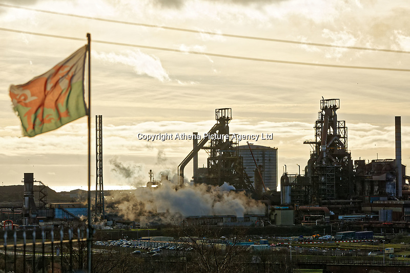 Pictured: A welsh flag flies by the blast furnaces of the steel works as seen over nearby roof tops in Port Talbot, Wales, UK. Monday 29 January 2018<br /> Re: Some of the Port Talbot steel workers' pensions are under threat after being persuaded to change providers.