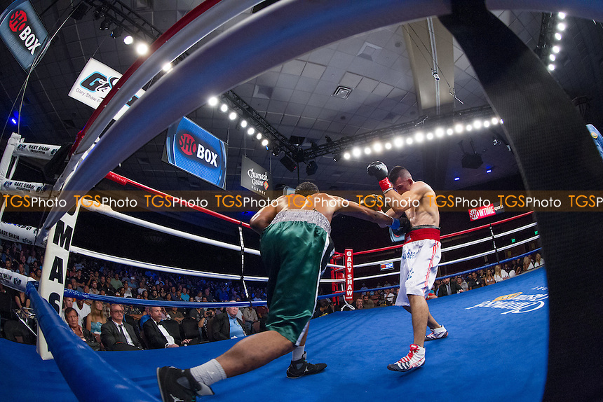 Francisco Santana defeats Larry Smith in a welterweight boxing contest promoted by ShoBox, The New Generation, at the Chumash Casino Resort, California - 20/07/12 - Dwight McCann/TGSPHOTO - Self billing applies where appropriate - 0845 094 6026 - contact@tgsphoto.co.uk - NO UNPAID USE.