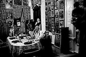 Moscow, Russia  .1998.Ear glued to his mobile phone, sculptor, painter, architect Zurab Tseriteli takes lunch in a small dining room of his massive home/studio in central Moscow. His walls are covered with his, and only his, paintings..