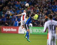 Santa Clara, California -Saturday, March 29, 2014: Andy Dorman of NE Revolution and Chris Wondolowski of SJ Earthquakes jumps for the ball during a match at Buck Shaw Stadium. Final Score: SJ Earthquakes 1, NE Revolution 2