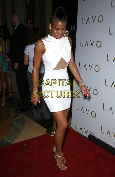 Cassie (Casandra Elizabeth Ventura) .hosts King of Hearts party at Lavo inside The Palazzo Las Vegas, Nevada, USA, 14th July 2012..full length white dress cut out mesh sleeveless  gold sandals .CAP/ADM/MJT.© MJT/AdMedia/Capital Pictures.