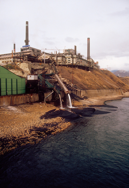 Teck Cominco; controversial lead and zinc smelter, visible tailings, pollution going into the Columbia Rver at Trail, British Columbia. Image taken in 1988