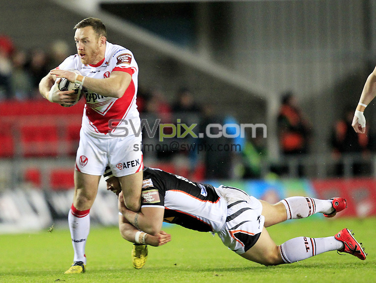 PICTURE BY CHRIS MANGNALL /SWPIX.COM...<br /> Rugby League - Super League - St Helens Saints v Castleford Tigers   - Langtree Park Stadium, , England  - 04/03/16<br /> St Helens James Roby  tackled by Castleford's Grant Millington and Lee Jewitt
