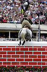August 08, 2009: Capt. Shane Carey aboard River Foyle competing in the Puissance event . Land Rover International Puissance. Failte Ireland Horse Show. The RDS, Dublin, Ireland.