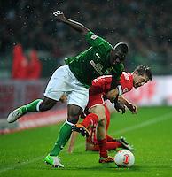 FUSSBALL   1. BUNDESLIGA    SAISON 2012/2013    12. Spieltag   SV Werder Bremen - Fortuna Duesseldorf               18.11.2012 Assani Lukimya (li, SV Werder Bremen) gegen Andreas Lambertz (re, Fortuna Duesseldorf)