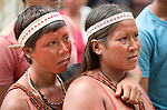 Two women participate in a march by indigenous people through the streets of Atalaia do Norte in Brazil's Amazon region on March 27, 2019. They were protesting a central government plan to turn control of health care over to municipalities, in effect destroying a federal program of indigenous health care. Indian rights activists are worried that the government of President Jair Bolsonaro is reducing or eliminating protections for the country's indigenous people.