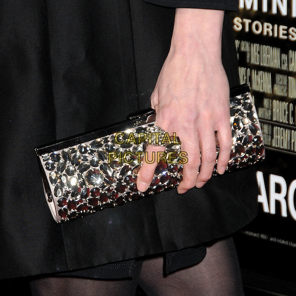 "MICHELLE FORBES' BAG.HBO's ""The Pacific"" Mini-Series Premiere held at Grauman's Chinese Theatre, Hollywood, California, USA..February 24th, 2010.hand silver embellished jewel encrusted ring black clutch bag .CAP/ADM/BP.©Byron Purvis/AdMedia/Capital Pictures."