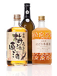 Japanese sweet sake bottles, White crane plum wine umeshu, benikikusui premium plum sake and premium-shinluchu apricot liquor isolated on white background