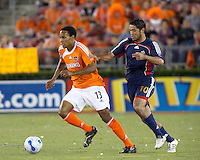 Houston Dynamo midfielder Ricardo Clark (13) dribbles away from Chivas USA forward Juan Pablo Garcia (10).  Houston Dynamo beat CD Chivas USA 2-0 at Robertson Stadium in Houston, TX on October 29, 2006 to gain a berth in the Western Conference Final on a 3-2 aggregate.