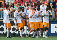 18 July 2009: Houston Dynamo players celebrate a goal by Houston Dynamo defender Bobby Boswell #32 during a game between the Toronto FC and Houston Dynamo..The game ended in a 1-1 draw..