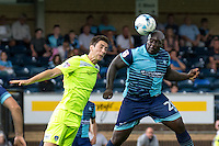 Adebayo Akinfenwa of Wycombe Wanderers heads at goal while Luke Prosser of Colchester United challenges during the Sky Bet League 2 match between Wycombe Wanderers and Colchester United at Adams Park, High Wycombe, England on 27 August 2016. Photo by Liam McAvoy.