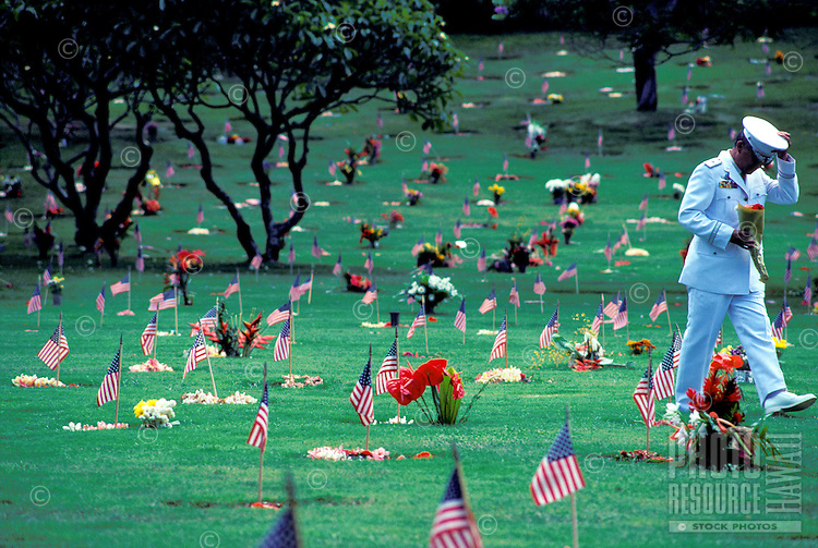 EDITORIAL ONLY. Sailor pays respects at Punchbowl, National Memorial Cemetary of the Pacific, Oahu