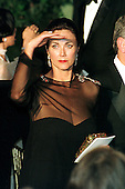 Lynda Carter Altman, wife of Washington, D.C. attorney Robert A. Altman, shields her eyes from the glare of the floodlights following the Official Dinner honoring Japanese Prime Minister Keizo Obuchi at the White House in Washington, D.C. on May 3, 1999.  .Credit: Ron Sachs / CNP