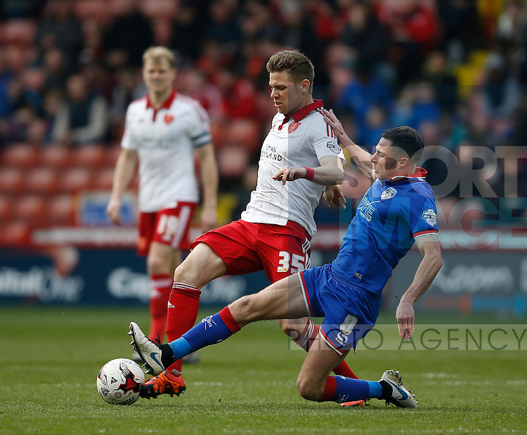 Dean Hammond of Sheffield Utd tussles with Mike Jones of Oldham Athletic during the Sky Bet League One match at The Bramall Lane Stadium.  Photo credit should read: Simon Bellis/Sportimage