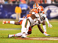 Charlotte, NC - DEC 2, 2017: Clemson Tigers linebacker Dorian O'Daniel (6) tackles Miami Hurricanes tight end Michael Irvin II (87) for a loss during ACC Championship game between Miami and Clemson at Bank of America Stadium Charlotte, North Carolina. (Photo by Phil Peters/Media Images International)