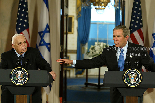United States President George W. Bush, right, speaks during a news conference with Prime Minister Ariel Sharon of Israel at the White House in Washington, DC. on April 14, 2004.  Bush announced he would support Israel's planned unilateral pullout from the Gaza Strip. <br /> Credit: Mark Wilson / Pool via CNP