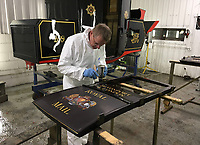 BNPS.co.uk (01202 558833)<br /> Pic: MarkBroadbent/BNPS<br /> <br /> Work in progress in Mark's Devon workshop.<br /> <br /> Last Post - Britain's last Royal Mail carriage, that bizarrely once survived an attack by a lion outside Salisbury, has been saved for the nation.<br /> <br /> The 200-year-old horse-drawn carriage harks back to the golden age of the Royal Mail when crowds gathered along the route to see the lightning-quick service thunder by.<br /> <br /> The restored four horse coach was known as 'Quicksilver' as it was the fastest in the land on its regular 21 hour run from Devonport, Devon, to London.<br /> <br /> But the red and black wooden wagon went down in history for an extraordinary incident involving a lion in the English countryside in 1816.