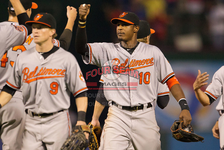 Baltimore Orioles outfielder Adam Jones #10 celebrates following the Major League Baseball game against the Texas Rangers on August 21st, 2012 at the Rangers Ballpark in Arlington, Texas. The Orioles defeated the Rangers 5-3. (Andrew Woolley/Four Seam Images).