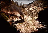 Freight with tank cars (CONOCO) along Gunnison River in Gunnison Canyon.<br /> D&amp;RGW  Gunnison area, CO
