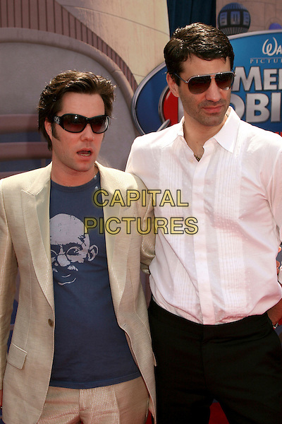 "RUFUS WAINWRIGHT & GUEST .""Meet The Robinsons"" Los Angeles Premiere at the El Capitan Theatre, Hollywood, California, USA..March 25th, 2007.half length sunglasses shades white shirt jacket beige suit print blue top.CAP/ADM/BP.©Byron Purvis/AdMedia/Capital Pictures"