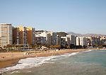 Playa de Malaguera sandy beach people sunbathing by the sea, Malaga, Spain
