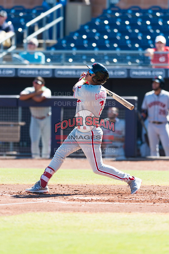 Scottsdale Scorpions third baseman Arquimedes Gamboa (7), of the Philadelphia Phillies organization, follows through on his swing during an Arizona Fall League game against the Peoria Javelinas at Peoria Sports Complex on October 18, 2018 in Peoria, Arizona. Scottsdale defeated Peoria 8-0. (Zachary Lucy/Four Seam Images)