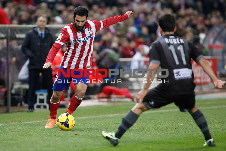 Atletico de Madrid¬¥s Arda Turan (L) and  Levante¬¥s Ruben during La Liga 2013-14 match at Vicente Calderon stadium, Madrid. December 21, 2013. Foto © nph / Victor Blanco)