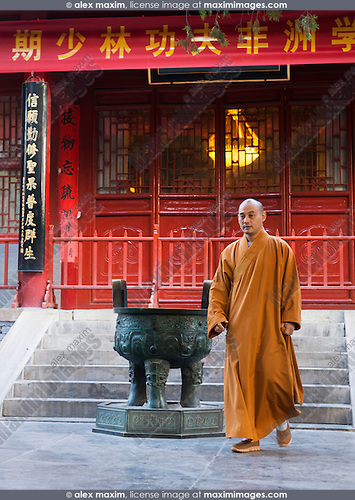 Master Shi Guo Song, Shaolin monk, exiting the abbot's room at the Shaolin Temple in DengFeng, Zhengzhou, Henan Province, China
